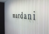 Mardani Fine Minerals Corporate ID - Installed Thru Silk Curtain to Drywall with 4